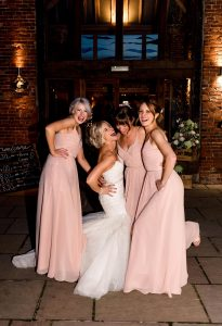 Kirsty and Yuvender's wedding at Packington Moor Farm by Lisa Carpenter Photography, West Midlands Wedding Photographer. Bridesmaids having fun with a night time couple portrait to finish the evening.