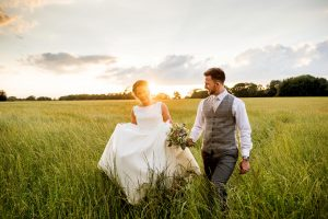 Goldstone Hall Wedding with photos by West Midlands Wedding Photographer Lisa Carpenter Photography. Golden hour portrait shoot in the hay fields opposite Goldstone Hall.