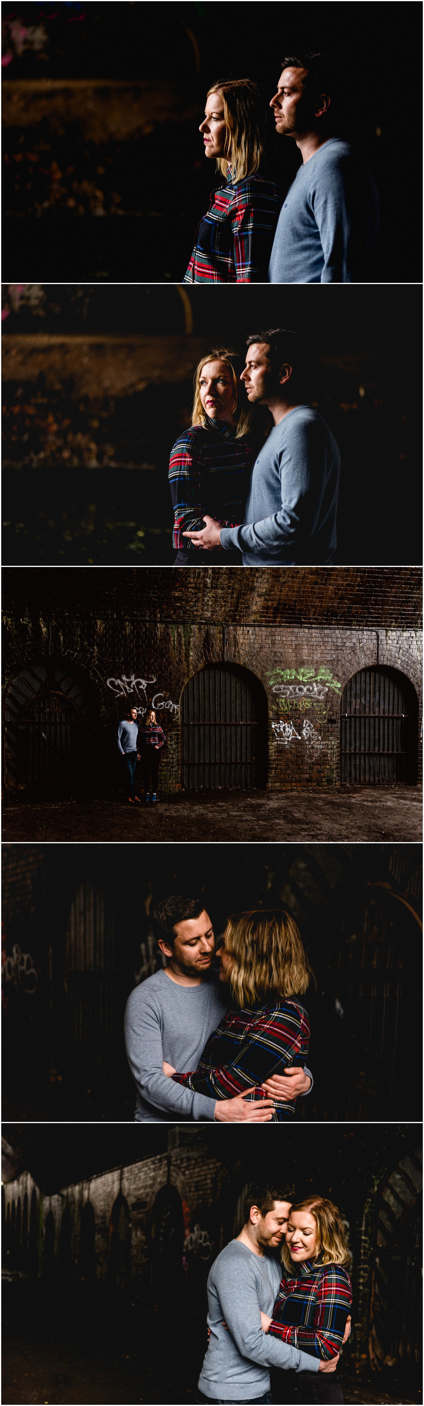 Darkly lit portrait of Bec and Stu underneath the canal tunnels of Birmingham in the Jewellery Quarter