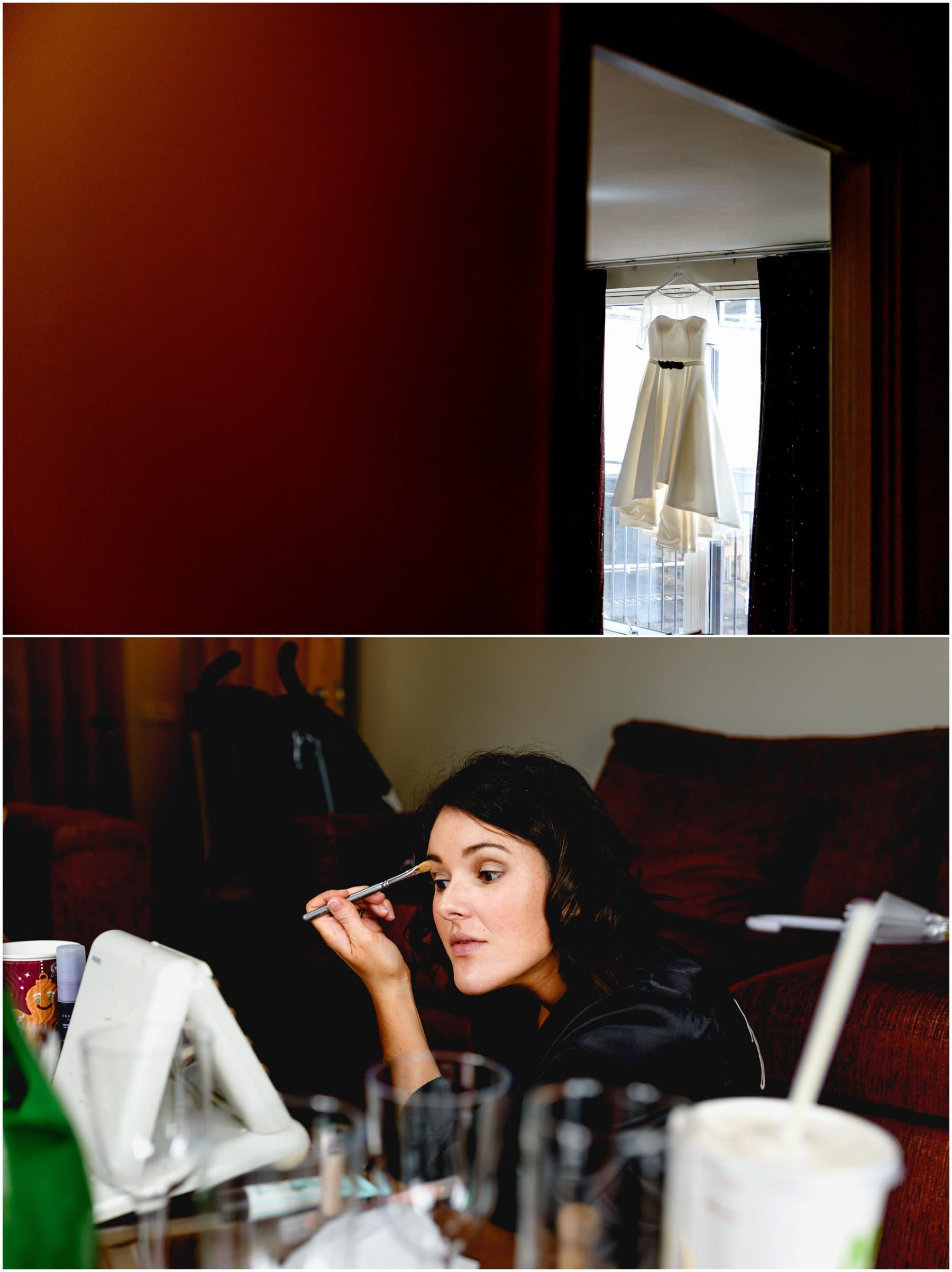 Bridal preparation photos, dress hanging in window and bridesmaid putting on make up in Birmingham Hotel