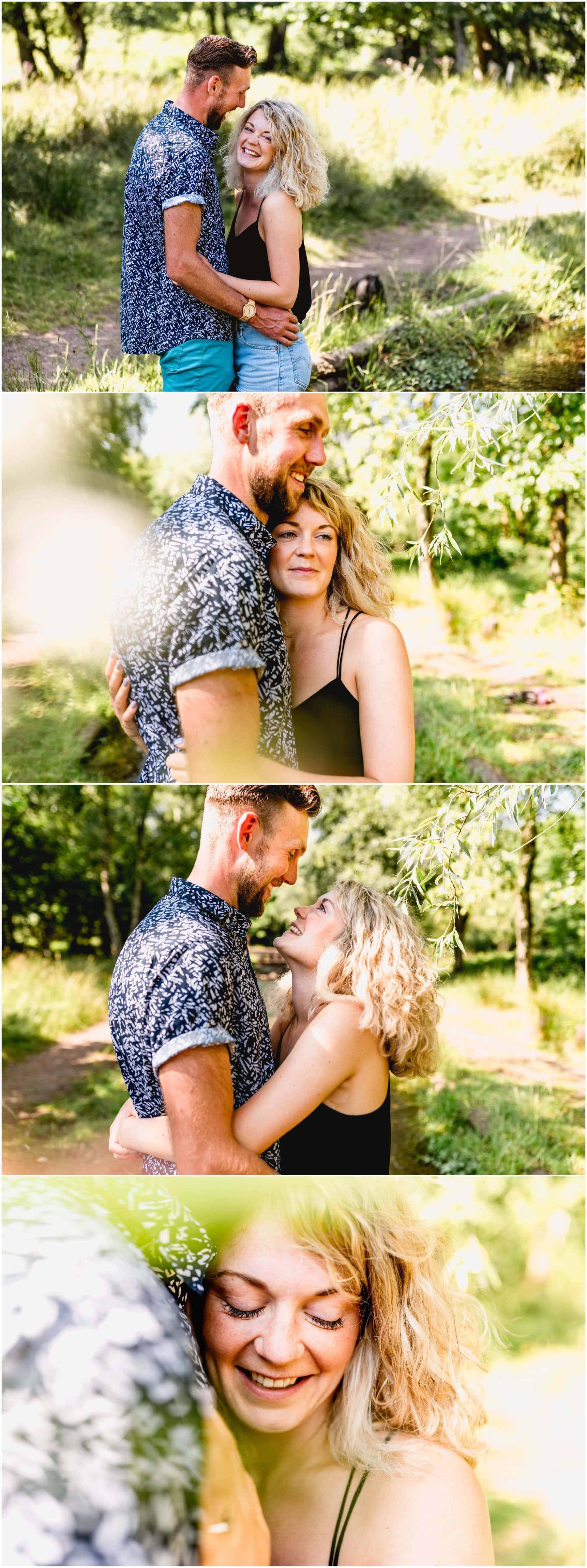 beautiful engagement shoot with couple standing in stream cuddling