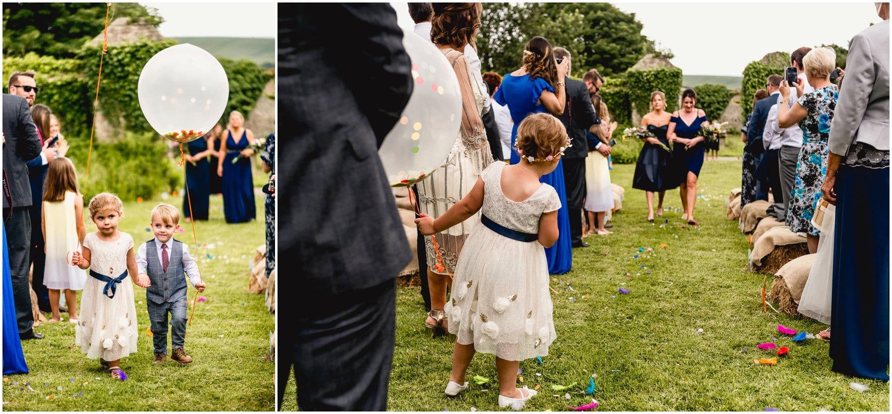 Flower girl and page boy walk down aisle at outdoor ceremony at Ash Barton Estate in Devon.