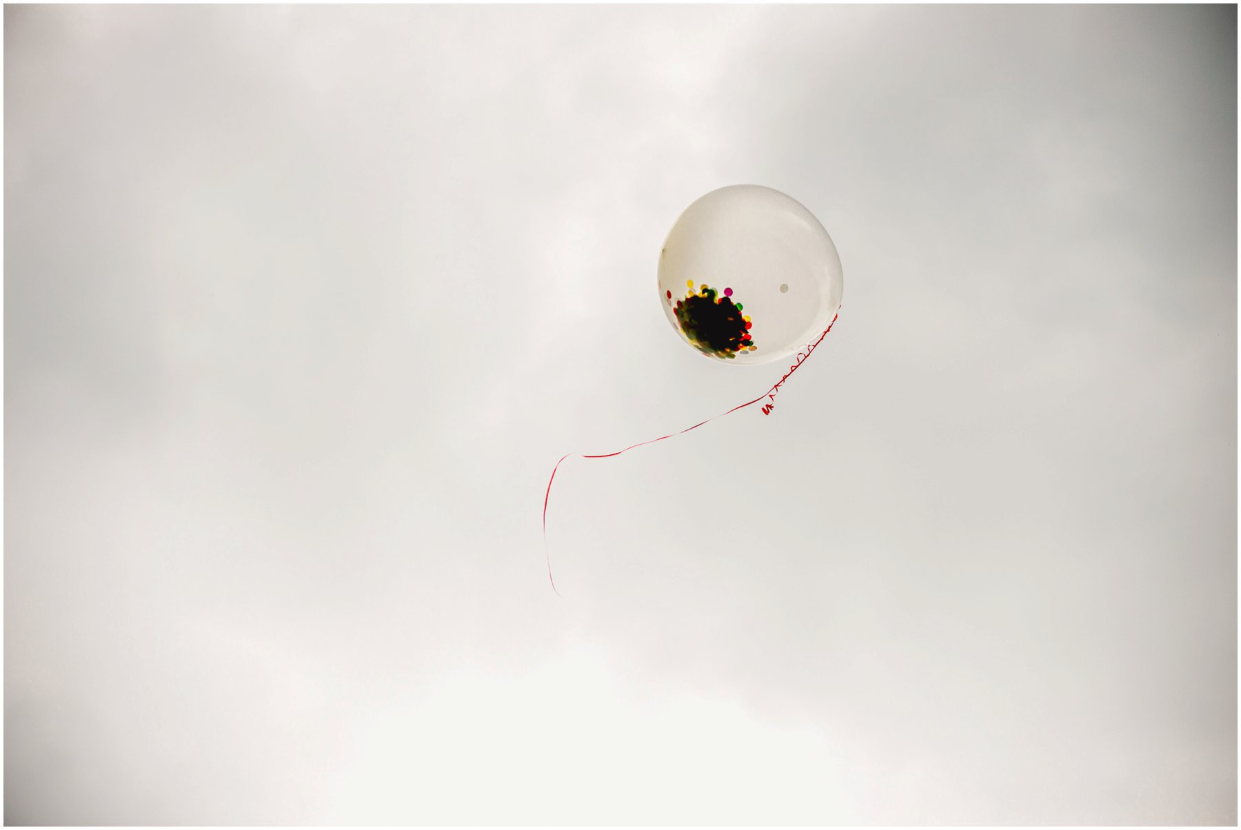 Confetti balloon flying off into the sky.