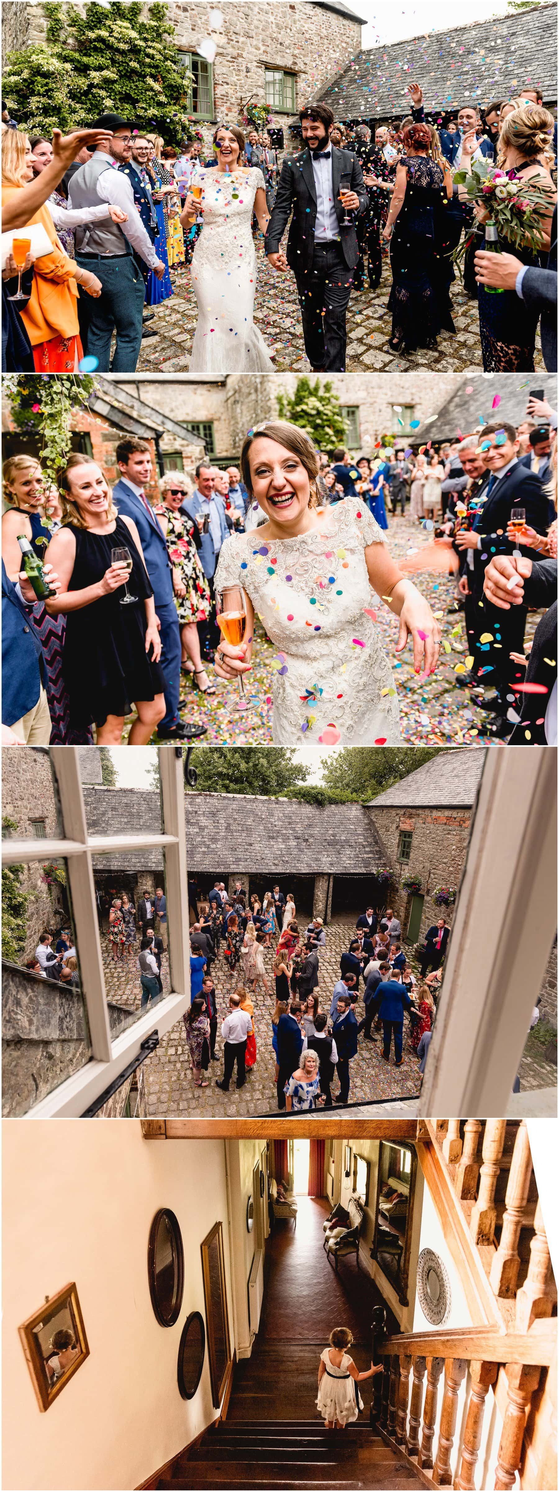 Colourful confetti tunnel during summer wedding outside.