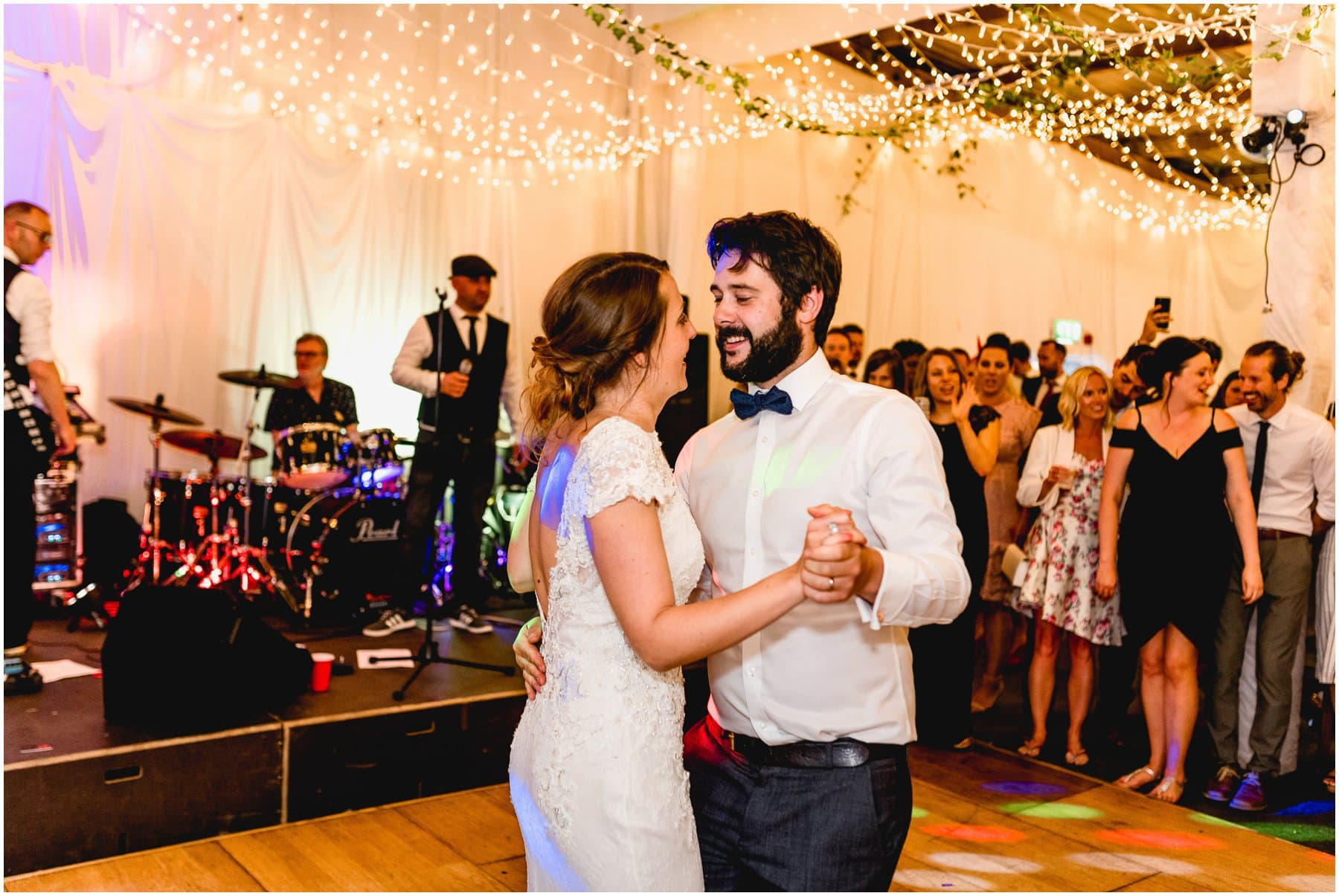 Jenna and Ben do first dance in the barn at their wedding in the Ash Barton Country Estate in Devon.