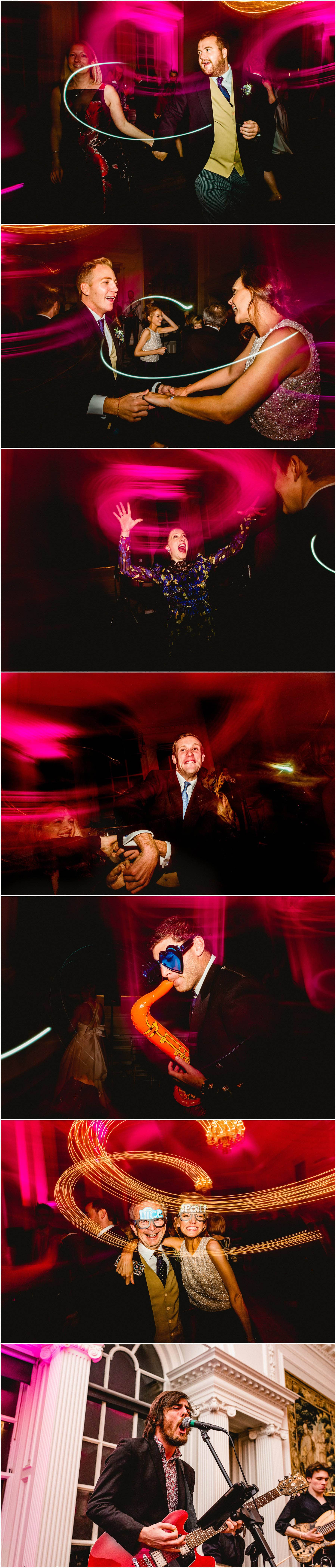 Photos of dancing at Hopetoun House during wedding reception with light trails and inflatables on dance floor.